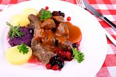 picture of deer meat  - Red deer goulash with potato Burgundy sauce and wild berries top view - JPG