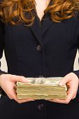 Female Holding Stack Of Cash