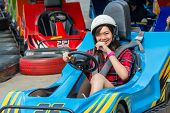 Cute Thai Girl Is Driving Go-kart From The Starting Point