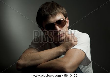 Dark Portrait Of A Young Man In Sunglasses