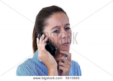 Middle Aged Business Woman Thinking While On The Phone