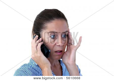Middle Aged Business Woman Looking Shocked On The Phone