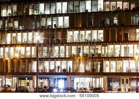 The Lights In The Windows Of An Office Building