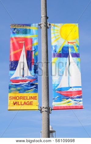 LONG BEACH, CA - September 21, 2012:  Shoreline Village banners on a light pole, Long Beach, California. Shoreline Village is a popular tourist destination with shops, restaurants on the waterfront.