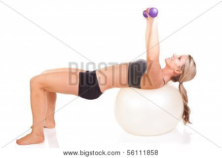 A fit woman doing an exercise routine on an exercise ball