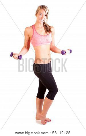 Portrait of pretty young woman weight training arm curl exercises with dumbbells