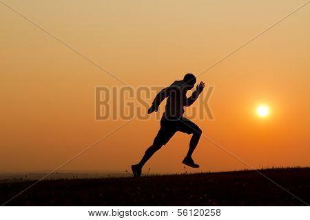 Silhouette sprinter running uphill