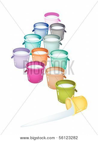 Set Of Twelve Multicolored Buckets On White