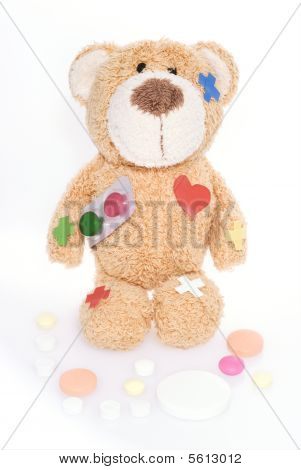 Teddy Bear In Hospital,holding Red And Green Pill