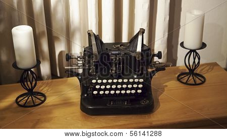 Antique Typewriter on Cabinet with Candles