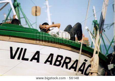 Fisherman Resting On His Boat, Angra Dos Reis, Brazil