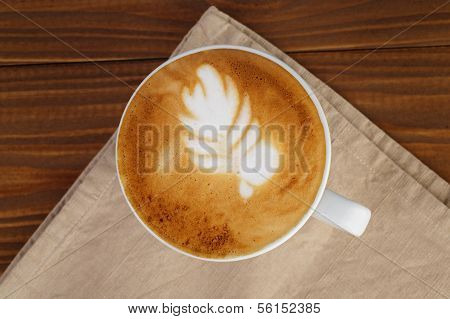 Freshly Made Cup Of Cappuccino With Leaf Art