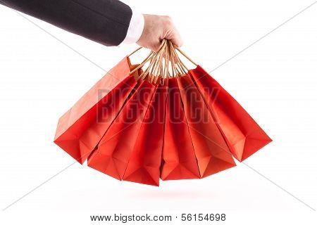 Man Holding Red Shopping Bags