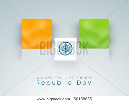 Happy Indian Republic Day concept with national flag colors board with Asoka wheel on grey background.