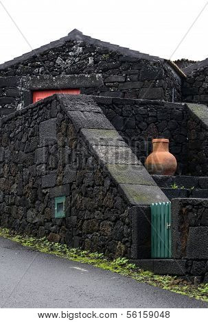 Orange Amphora On Black Wall, Pico Island, Azores Archipelago (portugal)