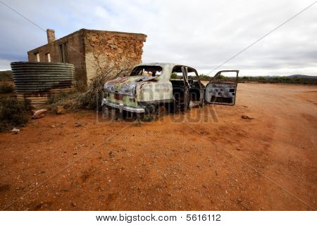 Abandoned Wrecked Car And House
