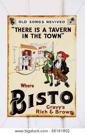 NR SOUTHAMPTON,UK - 25 June 2013: Old style tin advertising board for Bisto gravy browning displayed on painted wood background. On 25 June 2013 Near Southampton UK