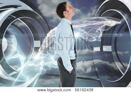 Happy businessman standing with hand in pocket against cloud and energy design on a futuristic structure