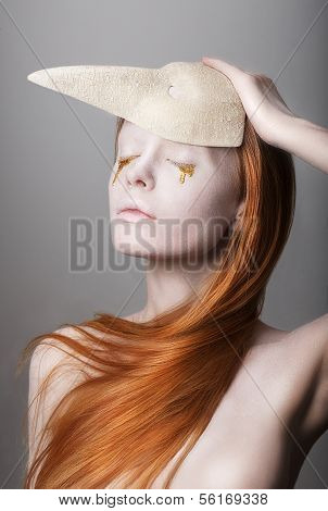 Fantasy. Stylized Woman With Golden Teardrops Holding Carnival Mask