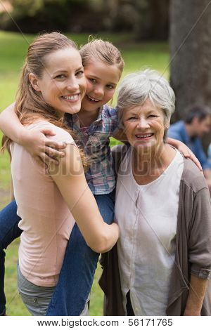 Portrait of grandmother, mother and daughter standing at the park