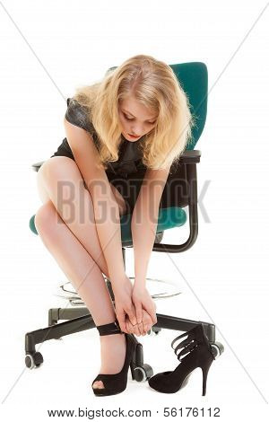 Work Stoppage And Foot Pain. Business Woman On Chair Taking Shoes Off.