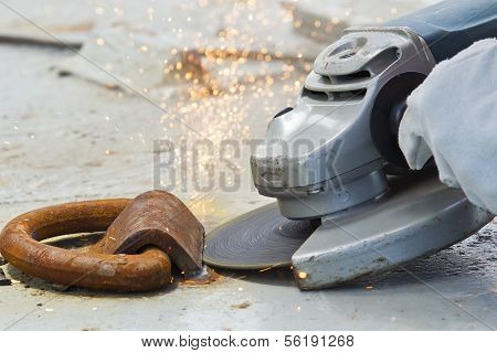 Angle grinder cutting through steel