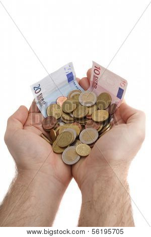 Two hands holding some cash and several bank notes. All isolated on white background.