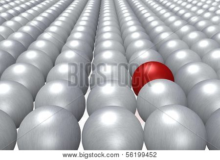 A single red ball fully integrated in a crowd of grey balls.