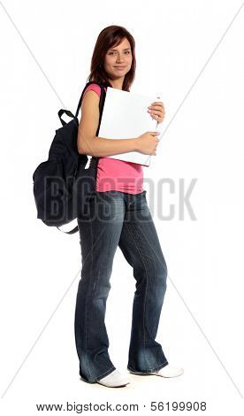 An attractive female student standing in front of a plain white background.