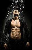 foto of cataracts  - the very muscular handsome sexy guy under shower naked torso - JPG