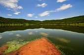 stock photo of meteorite  - Tswaing Meteorite Crater Reserve. Lake & vegetation surrounding the Tswaing Meteorite Crater Reserve in Soshanguve SA 40km from Pretoria The impact crater was left by an asteroid 200000 years ago.
