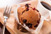 stock photo of chocolate muffin  - Homemade cranberries and chocolate muffin and cup of coffee - JPG
