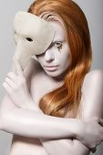 stock photo of teardrop  - Stylized Woman with Carnival Mask - JPG