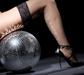 image of fetish fishnet stockings  - party dancer girl in fishnet stockings with disco ball - JPG