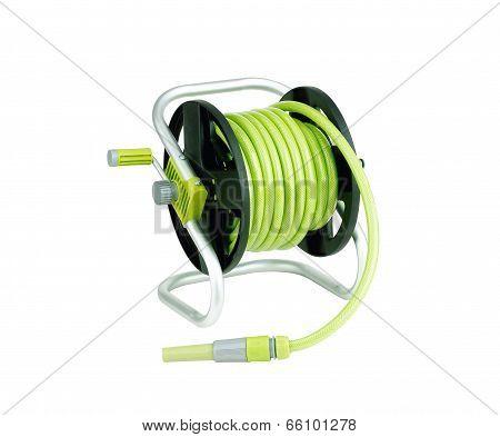 green garden hose coiled with spray nozzle