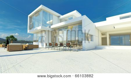 Modern angular whitewashed luxury tropical villa with huge glass windows overlooking a paved patio with an outdoor living area and furniture