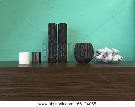 Modern interior decor with vases and candles arranged on a wooden cabinet against a green painted wall with copyspace