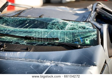 Close up of the shattered windscreen and wipers of a car that has been involved in an accident