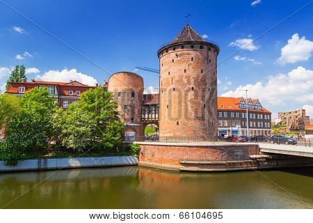 GDANSK, POLAND - 20 MAY: 15th century fortification tower and gate to the old town of Gdansk on 20 May 2014. Gdansk is the historical capital of Polish Pomerania with medieval old town architecture.