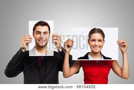 People holding portraits of other people