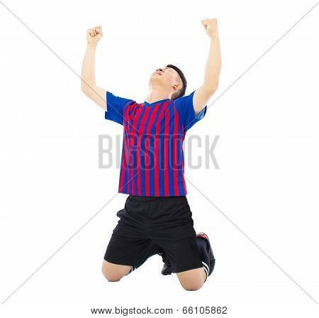 Young Soccer Player And Raised Hands To Celebrate Winner