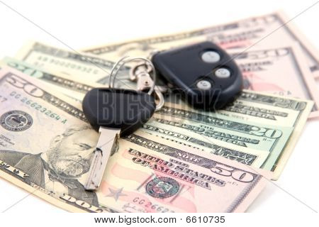 Car Key And Dollars Isolated On White