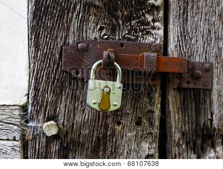 The Metal Lock On A  Old Wooden Door
