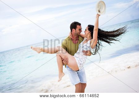 Playful couple at the beach sharing a fun moment