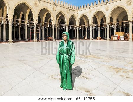 The Girl In The National Egyptian Attire In The Mosque Of Amr Ibn Al Asa In Cairo, Egypt