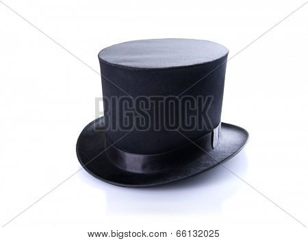 Black classic top hat, isolated on white background with natural shadow and reflection