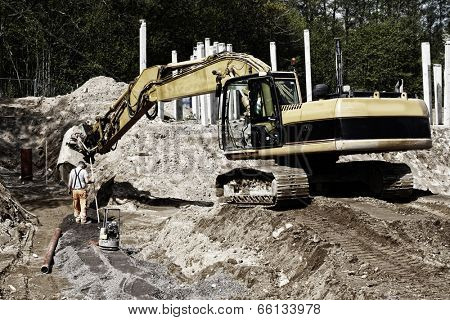 giant bulldozer, digger in action, road works and construction industry