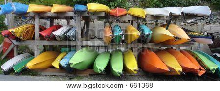 Colorful Rack Of Kayaks