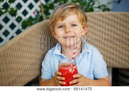 Little Blond Boy Drinking Healthy Watermelon Juice In Summer.