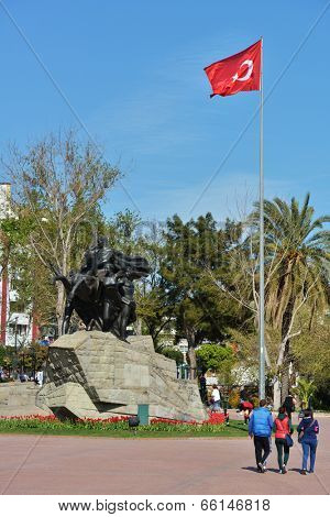 ANTALYA, TURKEY - MARCH 26, 2014: People walking under the monument to Ataturk on the Cumhurriet square. Monument erected in 1928 in memory of the Antalya liberation from the  foreign invaders in 1921